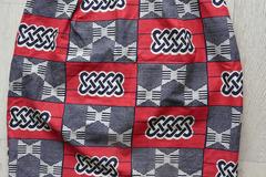 Vente au détail: jupe droite ethnique wax rouge/noir