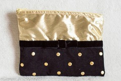 Vente au détail: Trousse au nœud noire et or 21 cm x 15 cm