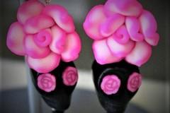 Selling:  Black skull earrings and pink rose flower eyes