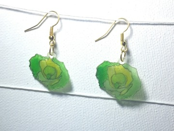 Sale retail: boucles d'oreille salade verte