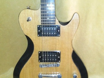 Renting out: Occhineri Custom Guitar.Golden Satinwood ,