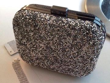 Ilmoitus: Kimalle laukku