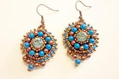 Vente au détail: Boucles  en perles brodées turquoise et cuivré
