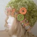 Vente au détail: Bonnet Crocheté main vert anis chiné vert/orangé.Boutons
