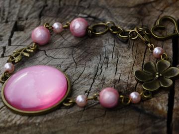 Vente au détail: Bracelet en bronze cabochon rose nacré, perles miracle roses