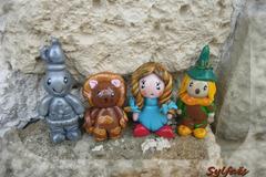 Vente au détail: Set de 4 figurines du magicien d'oz: Dorothy, l'homme de fer