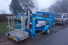 Daily Equipment Rental: Trailer Mounted Towable Cherry Picker Boom Lift Genie Access
