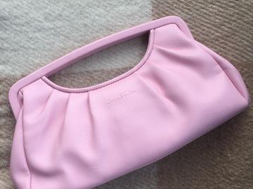 Ilmoitus: Vaaleanpunainen käsilaukku