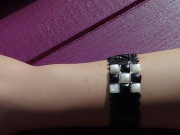 Vente au détail: Bracelet noir à damier