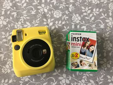 Ilmoitus: Vuokrataan Fujifilm Instax Mini 70 polaroid-kameraa