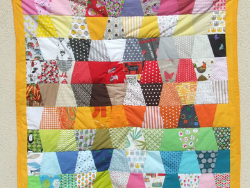 Sale retail: Plaid en patchwork cousu mains