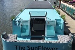 Rent per day: Solar powered house boat