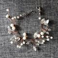 Ilmoitus: Rannekoru helmillä ja timanteilla