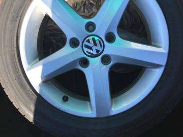 "Selling: 15"" OEM VW Wheels with good All Season Tires"