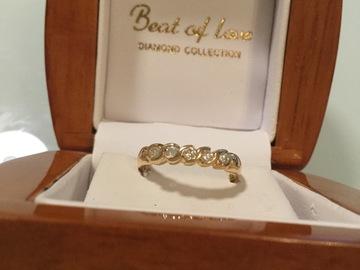 Ilmoitus: Keltakultainen Beat of love merkkinen timanttisormus