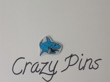 Sale retail: PIN'S REQUIN