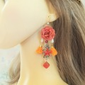 Sale retail: Boucles d'oreilles orange moutarde fleur pompon