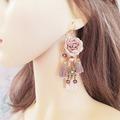 Vente au détail: Boucles d'oreilles marron fleur pompon