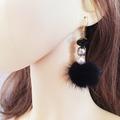 Vente au détail: Boucles d'oreilles noir , cristal et pompon