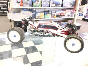 Selling: Team Associated RC10 with spare parts and tires.