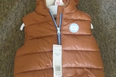 Selling with online payment: New body warmer, age 18-24 Mths