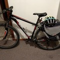 Daily Rate: second hand mountain bike with saddle bags, bike chain and helmet