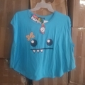 Make An Offer: Monster with Bandage Print  Blue Shirt