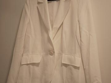 Ilmoitus: Valkoinen jakkutakki