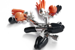 Selling with online payment: Orange black nipple clamps with tassels and jingle bells.