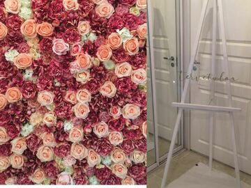 Ilmoitus: Kukkaseinä, maalausteline ja akryylinen Tervetuloa-kyltti lainaan