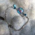 Vente au détail: Cabochon bleu résine et fleurs