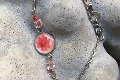 Vente au détail: Cabochon résine nacrée et fleur