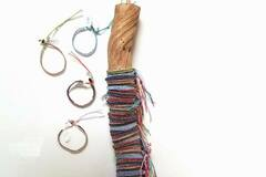Buy Now: Island Creations Assorted Beaded Bracelets On Wooden Display