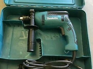 Renting out equipment (w/o operator): Makita 6 Amp 5/8 in. Corded Hammer Drill