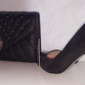 For Sale: Black Quilted Shell Dune Clutch