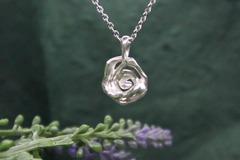 : tiny rose pendant