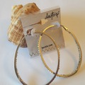 Buy Now: 12 Silver Rhinestone Hoop Earrings by The Buckle $130 Value