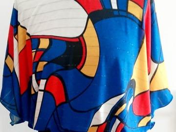 Vente au détail: Haut imprimé façon MONDRIAN sur fond bleu