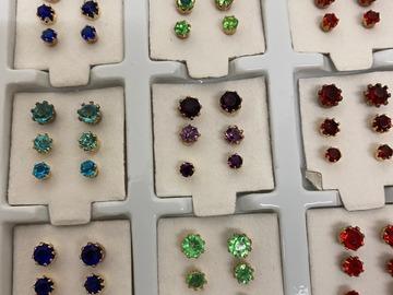 Buy Now: 1080 pairs-- Rhinestone trio earrings in display $ .033 pair!