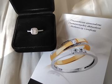 Ilmoitus: Valkokultainen timanttisormus (aitoustodistus)