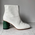 Selling: Snakeskin boot with green heel