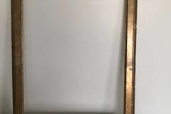 Ilmoitus: Kultaiseksi maalattu kehys