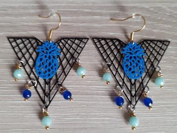Vente au détail: boucle d'oreille perle bleu