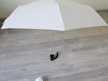 Ilmoitus: Valkoinen sateenvarjo