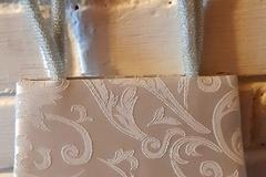 Ilmoitus: Vaaleansininen juhlalaukku