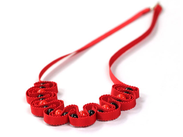 : Red ribbon necklace with ceramic beads