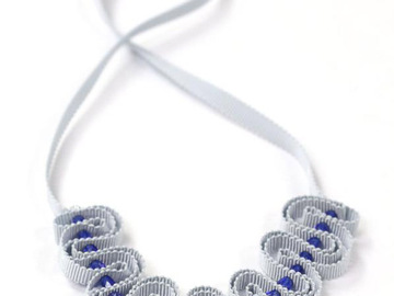 : Pale grey ribbon necklace with blue beads