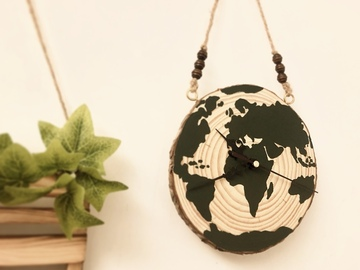 : Hand painted globe wood slice clock
