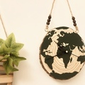 : Hand painted globe wood slice clock