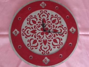 Vente au détail: Pendule ronde à arabesques